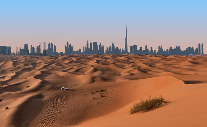 Dubai desert and skyline in distance