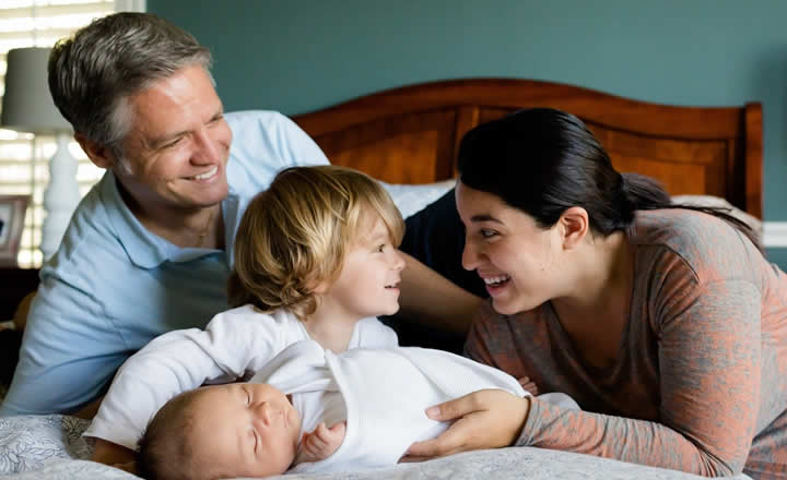 Family on hotel bed