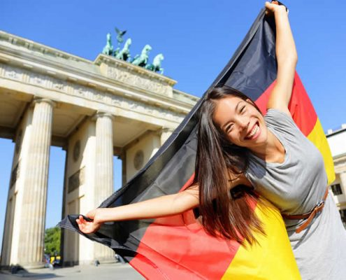 Female tourist holding German flag in Berlin