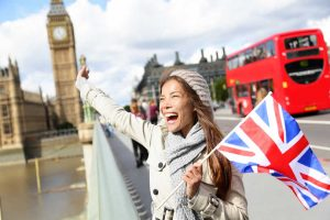 Woman holding British flag in London