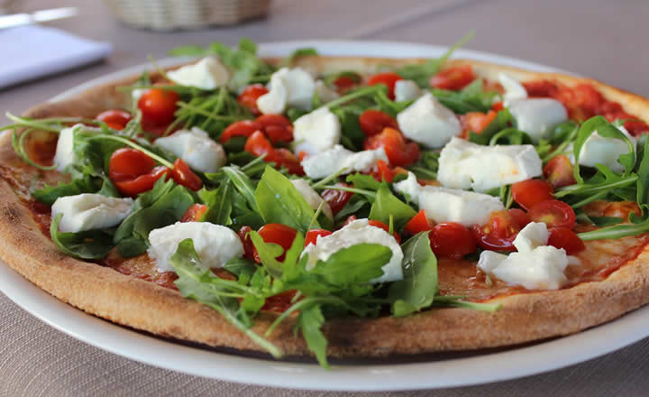 Pizza with mozzarella and tomatoes