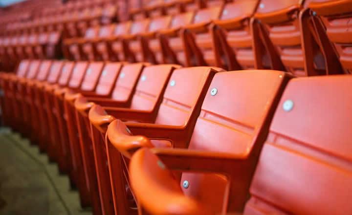 Red seats in football stadium