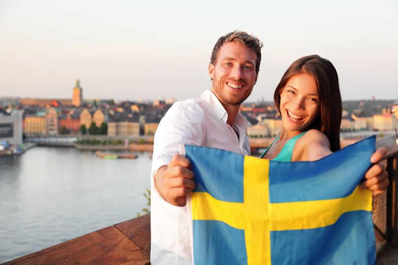 Tourists in Stockholm holding Swedish flag