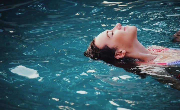 Woman swimming in hotel pool