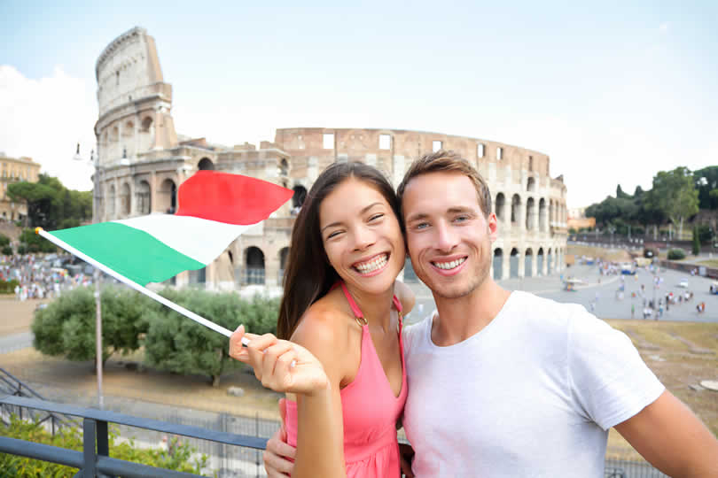Tourists in Rome holding Italian flag