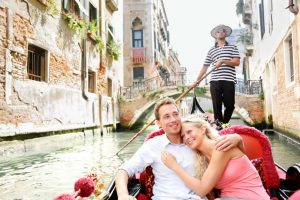 Venice couple taking gondola ride