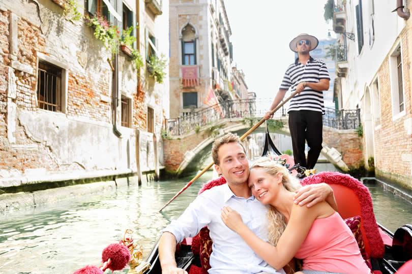Venice couple taking gondola ride